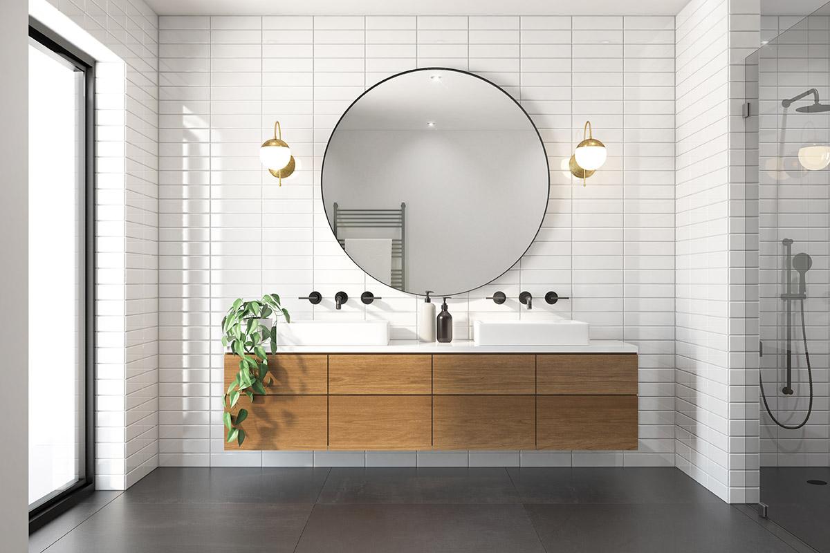 Grande specchio tondo per il bagno.