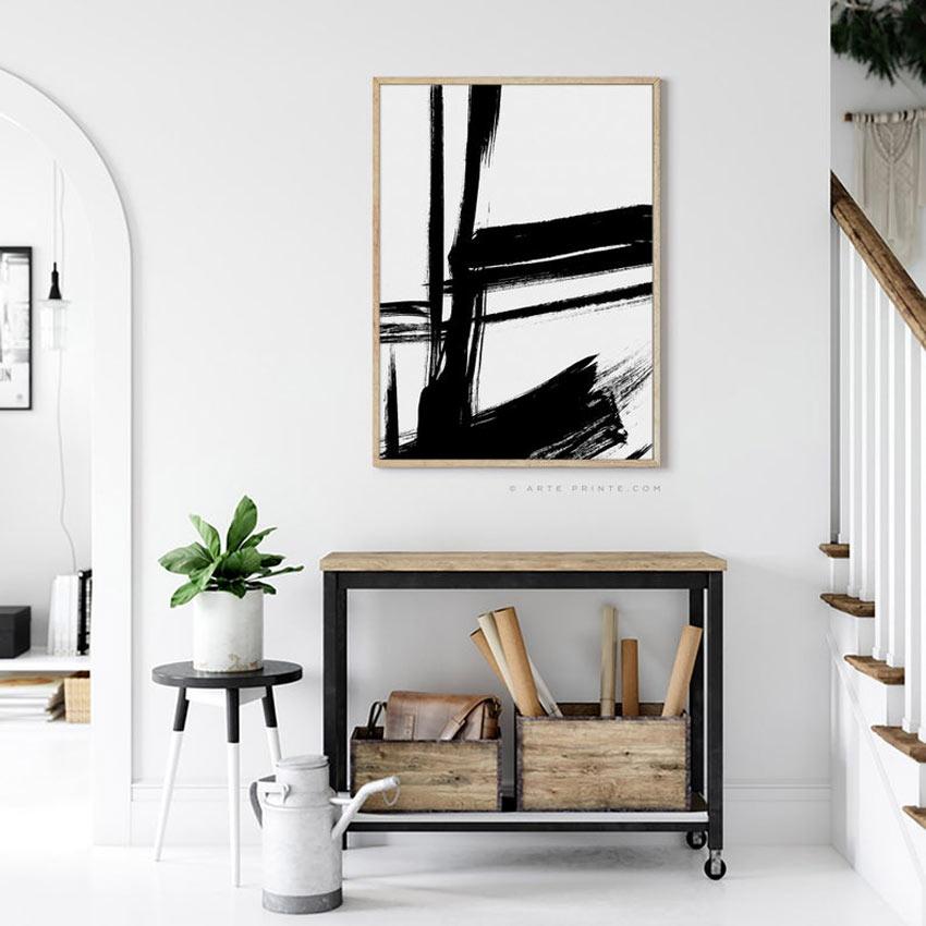 Quadro moderno bianco con pennellate nere, perfetto per decorare una casa moderna.