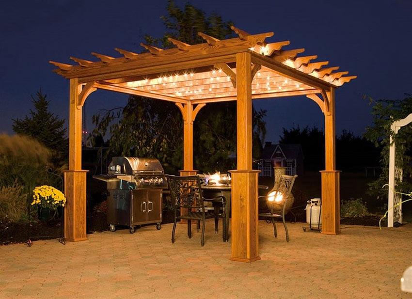 bellissima pergola di legno per il giardino con illuminazione