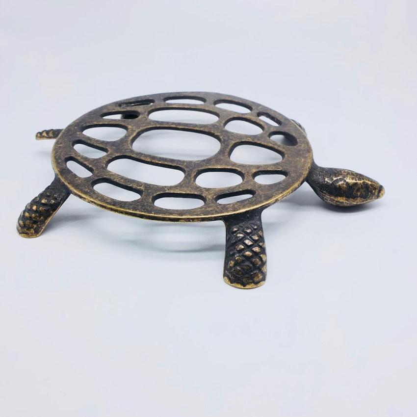 sottopentola originale in ferro a forma di tartaruga