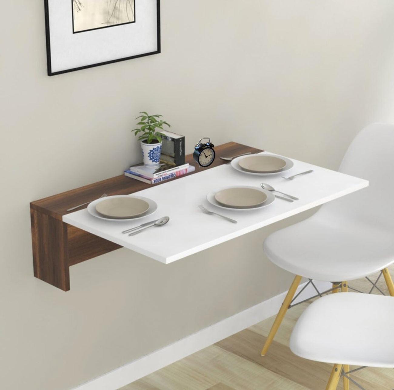 Tavolino pieghevole da parete salvaspazio.