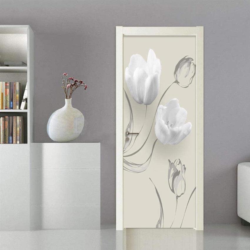 Sticker adesivo per porta interna con fiori bianchi.