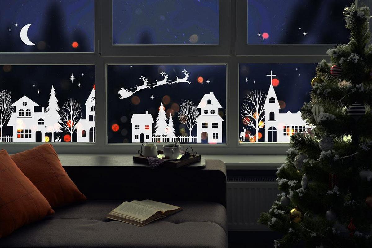Decorazioni natalizie alle finestre con adesivi