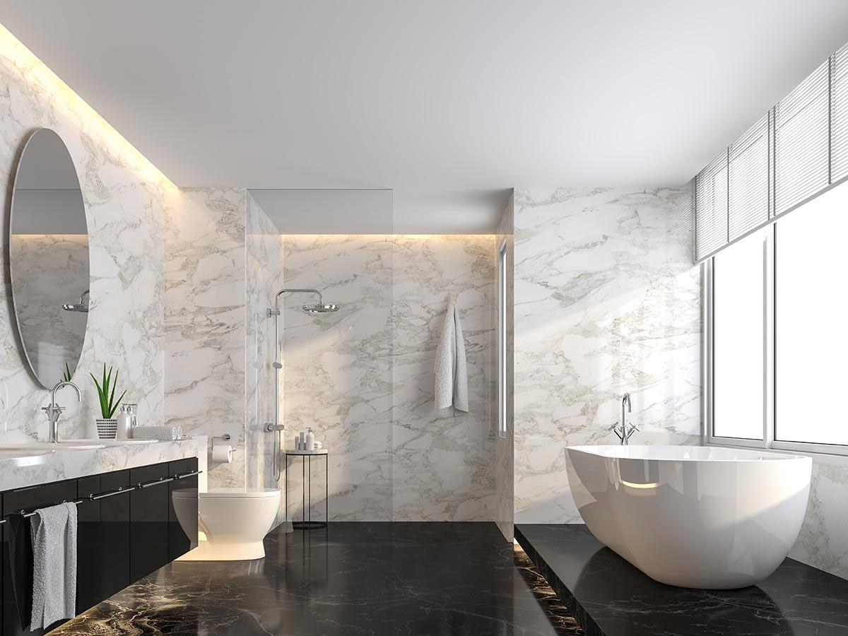 Gres porcellanato effetto marmo, pareti bianche e pavimenti neri.
